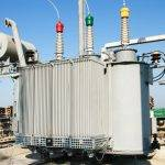 Transformer oil treatment while the transformer is energized